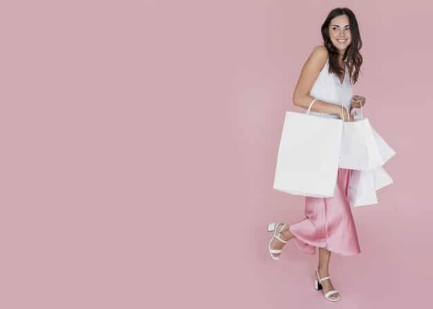 woman holding white shopping bags